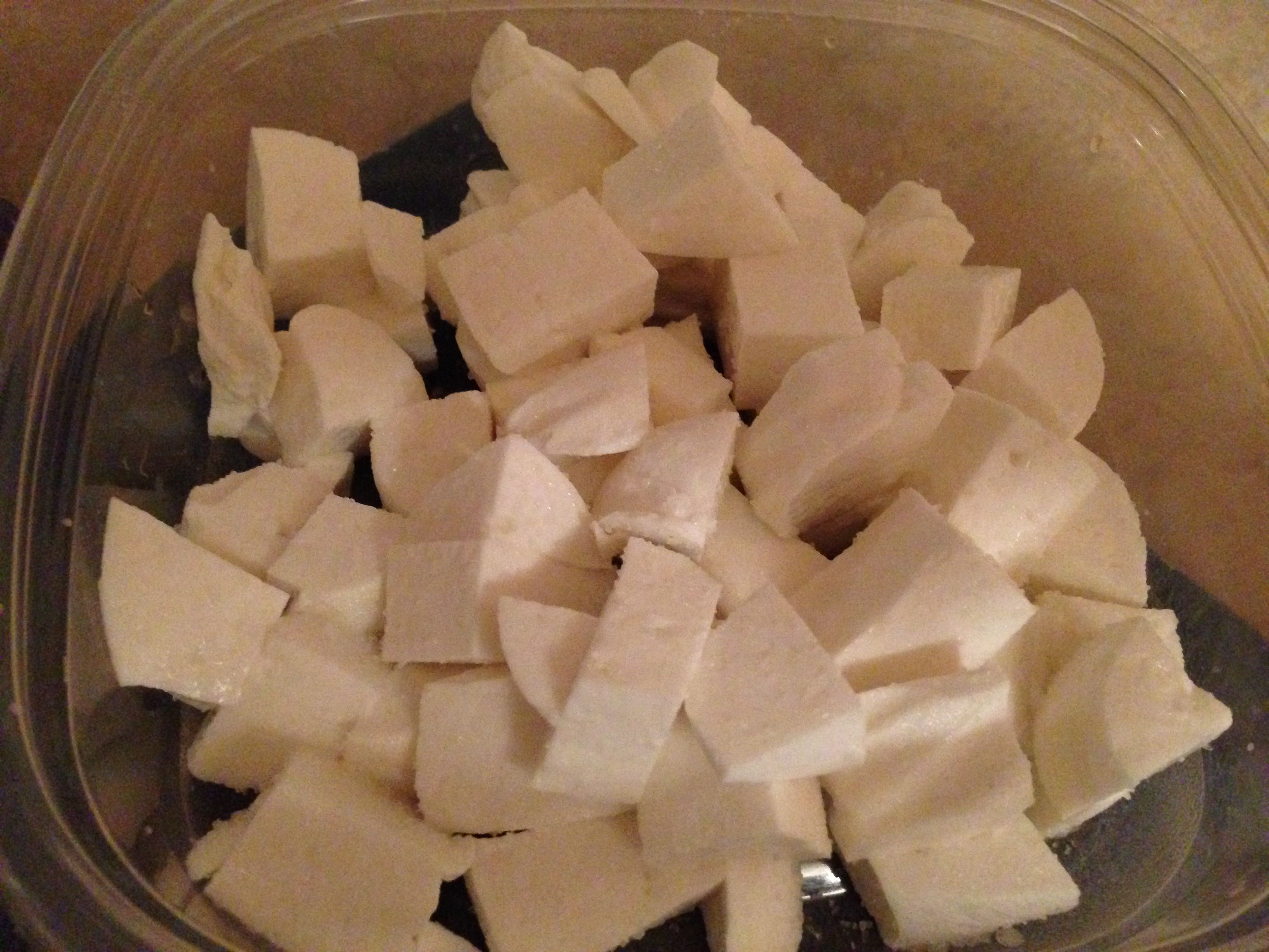Salted feta cubes, ready to ripen for a week.